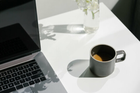 Laptop Open On Sunny Table In Home Office
